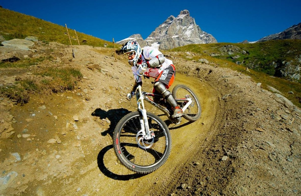 Mountain bike in Val d'Aosta district, below Cervino Mountain