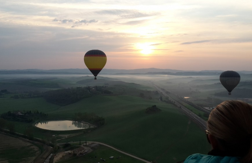 Hot air balloon flight in Siena sky and Crete Senesi